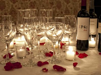 Glasses and wine w petals and candles
